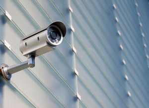 Surveillance Camera On Glass Facade