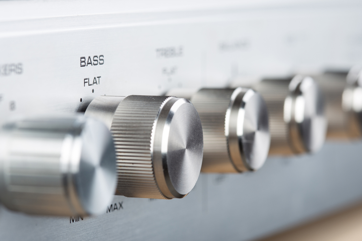 Control Knobs on a Silver Metallic vintage Amplifier - Shallow Depth of Field