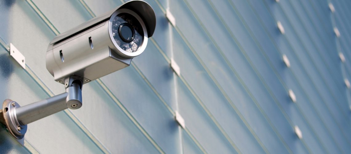 Surveillance Camera On Glass Facade